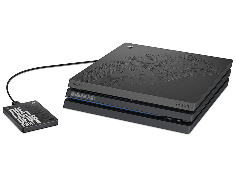 The bundle includes a Sony PS4 Pro console with matte finish and engraved Ellie's tattoo design