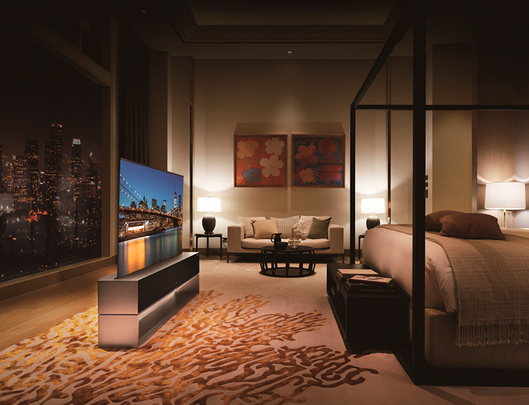 LG Signature OLED R in a room at night